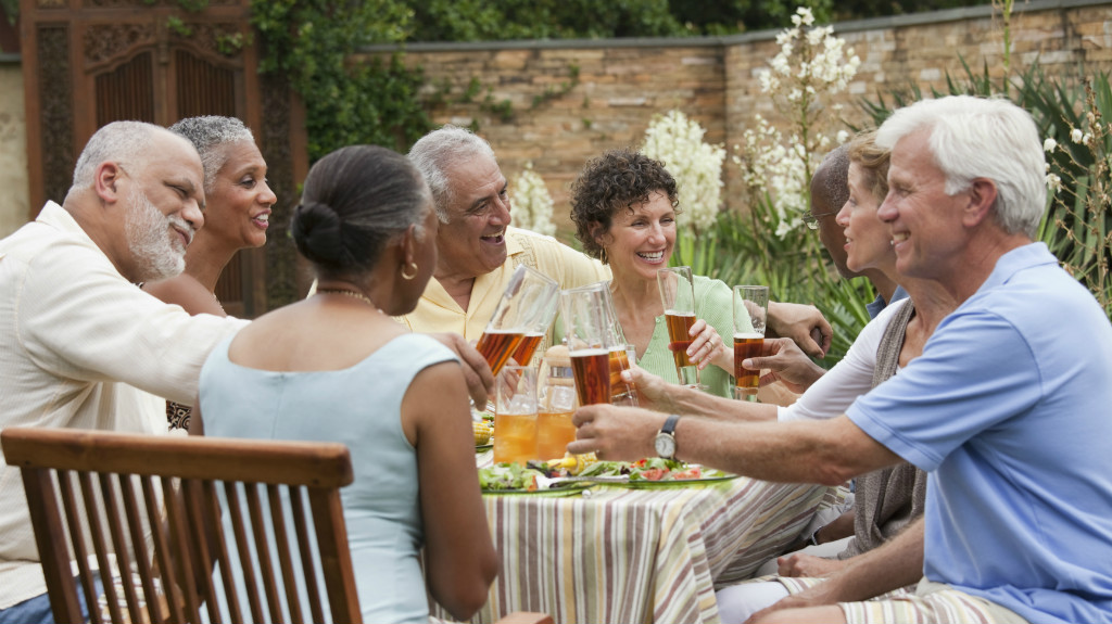 Active adults enjoying outdoor dinner party